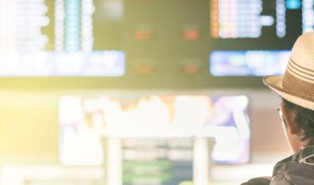 passenger reading flight information screens
