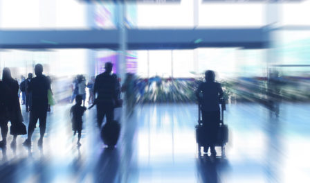 blurred image of people at airport